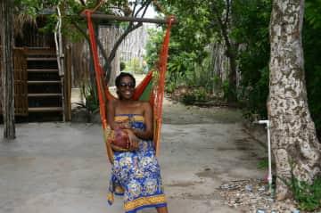 Aisha enjoying a swing in Jamaica