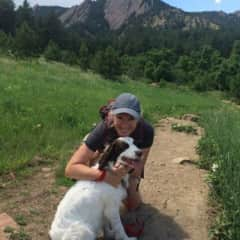 Karen and Remy hiking in the Flatirons in Boulder, CO