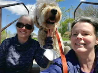 My friend and I with her beloved JoJo, the sweetest golden doodle ever.