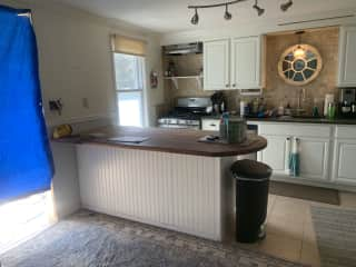 Kitchen island (there are 4 barstools available for dining).