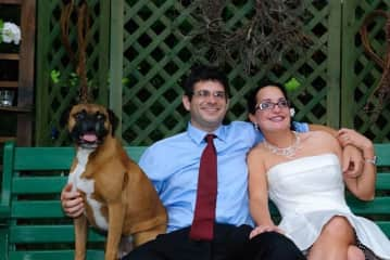 Me, Vince, and our late Boxer, Stella on our wedding.