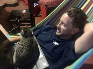 Robby working from a hammock in Colombia... and his new best friend.