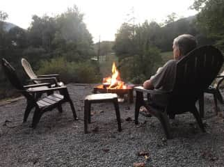 Dan enjoying a glass of wine by the fire pit