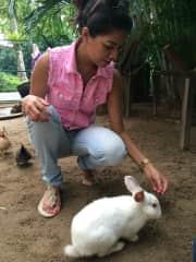 Nadia feeding a rabbit!