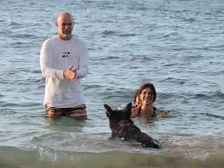 This is my husbandand I with our German Shepherd Nina who loved to play in the beach near our house.
