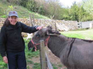 This is a shot of me with a donkey who lived up the street from us