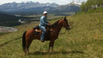 Out riding at Yahatinda ranch near the Rocky Mountains