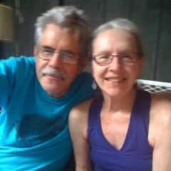 Edna and Todd sitting on porch deck