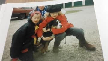 Little Simone with their grandma's gorgeous Austrian mountain Dog