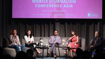Me moderating a panel discussion at a conference 2019