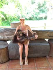 Monique in Thailand with her beautiful cuddly friend Manna