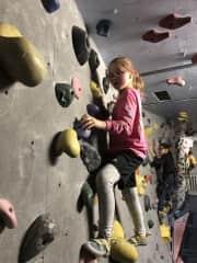 Bridget on the rock wall.