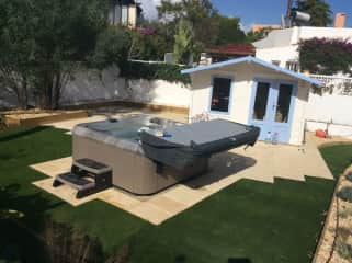 Back garden with spa, summer house and bbq