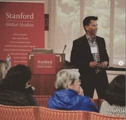 Presenting at Stanford University Global Studies symposium in 2019.