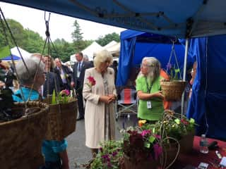 Helene explaining the basket business to the Duchess of Cornwall during a Royal Visit to the Farmers' Market in Picton in 2017.