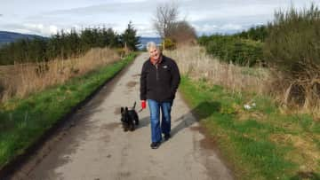 Ros walking Maudie in the Scottish Highlands