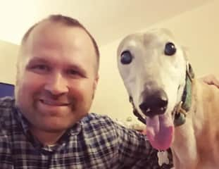 Jon with a beautiful retired racing greyhound that spent a week with us.
