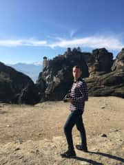 We love to travel. Here's a picture of me in Meteora, Greece, in January 2020.