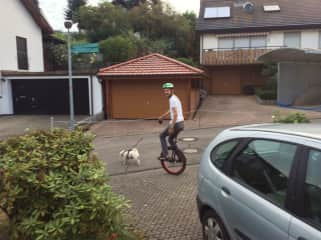 Doug with the pug on her morning walk.