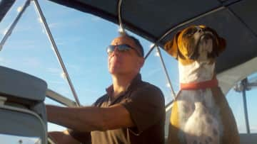 Lyle and our Boxer Zeke as first mate on our boat.