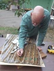 Don repurposes materials for art.  Creating.