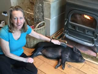 Deb and Peppa relax by the fire during a cold winters day in France