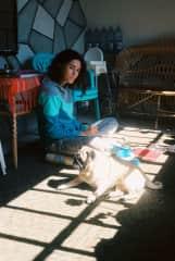 Adriana, drawing, and Mojo, sunbathing