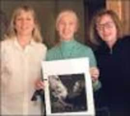 Author Karin Winegar with Dr. Jane Goodall and photographer Judy Olausen with one of the photos from our book
