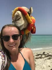 One of my favorite parts of travelling is befriending animals that I meet. Here i am with a camel in Djerba, Tunisia.