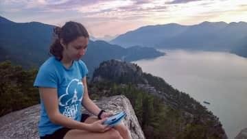Taking a break to read on a hike