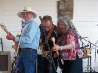 Scott on the left pretending to play the guitar!  Love the hat!