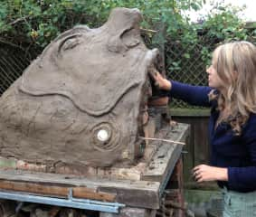 Building clay pizza oven in the garden