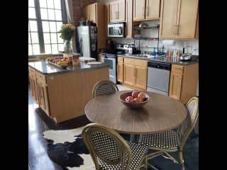 Fully equipped bright kitchen with extra work space on the  island.
