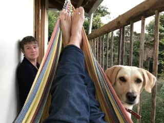 Leigh, James's legs, and Bella where we volunteered in Guatape, Colombia