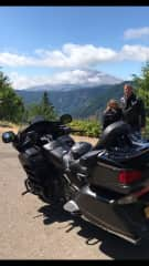 Pamela and Dale on a motorcycle trip with Mt. St. Helens in the background.