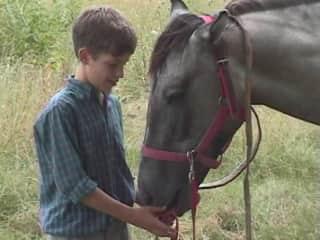 Carlos as a kid with his horse, Milennium.