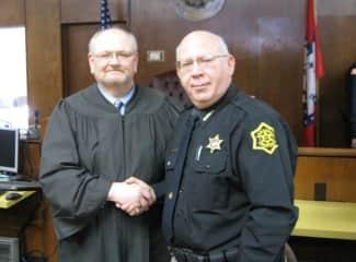 Craig did law enforcement in Arkansas and Cayman Islands