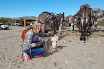 Linda can't resist animals, near Boquillas del Carmin, Mexico