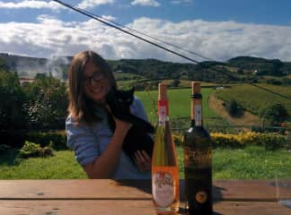 Befriending local cats while wine tasting in Spain