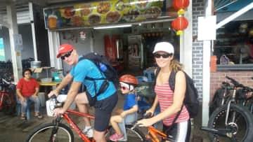 Colin, Elly and Ayla cycling on Pulau Ubin, Singapore