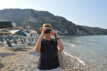 Sylvia in Corfu, doing what she likes to do a lot: taking pictures!