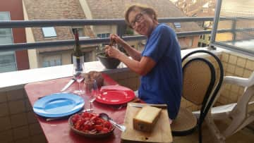 Me on my balcony. I love creating and sharing food.