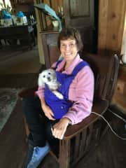 Beth with her neighbour's dog.  I made the carrier because he loved to be held.
