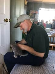 Margaret's husband Mark taking a break from his medical practice to help socialize & play with our fostercare kittens.