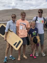 Surfing the sand dunes at  Great Sand Dunes National Park & Preserve