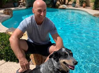Graeme with Portia hanging by the pool after a game of fetch