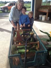 Maureen with grandchildren and food from the garden