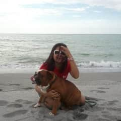 With Tank (our first pet, an English Bulldog who suddenly passed away in 2013...) on the beach sometime in 2010.