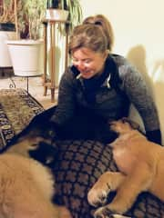 Me with two male puppies, Bo & Luke. Spent a month with them and took them to the veterans for shots and neutering. 4 walks each day plus several training sessions. Amazing young boys!