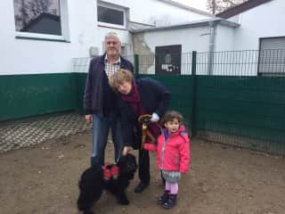 Wolfgang, Andrea, grandchild and our dog Jemba  in the dogs home when we picked him up